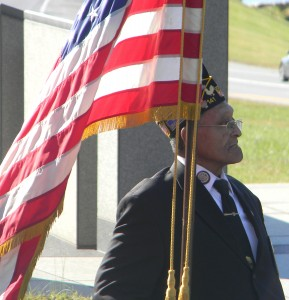Allen Pindell, who was an Airman Second Class in the U.S. Air Force, steadies the flag on Thursday morning during a Veterans Day ceremony at the Maryland World War II Memorial. Pindell, of Annapolis, served 13 years in the military, through the wars in Vietnam and Korea and the Cuban missile crisis.