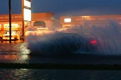 Car takes on floods. (Photo D. Allen Covey / Courtesy VDOT)