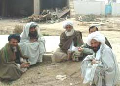 Afghan men sitting in a semi-circle