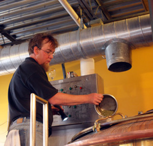 Noll adds hops to the wort / Newsline photo by Hannah Kim