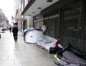 A homeless person's belongings line a storefront/Newsline photo by Steve Mendoza
