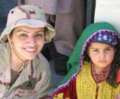 Maryam Khan with a little Afghan girl