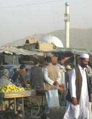Market scene in Kabul with mosque in background