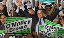 Anthony Brown, left, and Mayor Martin O'Malley celebrate their wins for Maryland lieutenant governor and governor.  (CNS-TV photo)